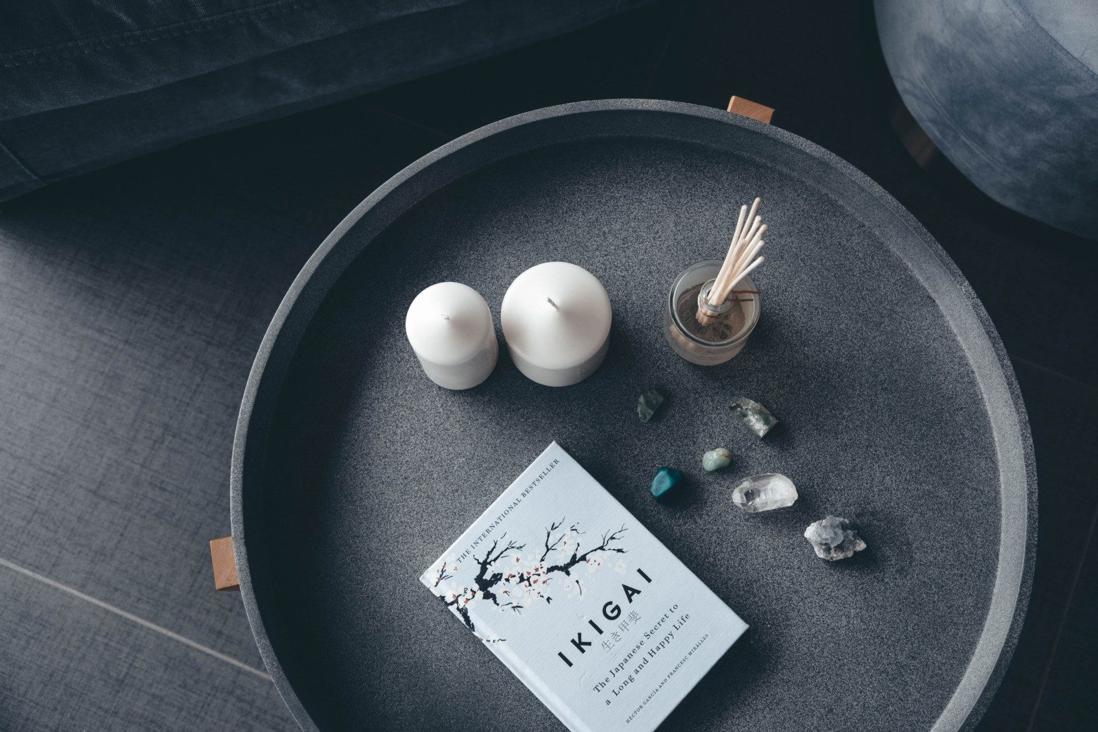 Ikigai book with candles, crystals and reed diffuser